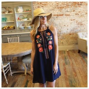 Navy floral embroidered tassel tie dress